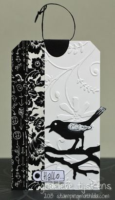 StampingMathilda: Black & White - 141 Dry embossed tag with decorative tape and a die cut