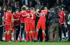 Wales manager Chris Coleman hugs Gareth Bale at the end of the win over Andorra