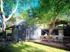 modern weatherboard + windows + u shape + seperate outdoor areas (one off master bedroom)