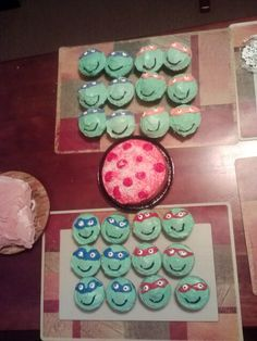 Zack's 6th bday! Pizza Cake with ninja turtle cup cakes! I made k.s. :)