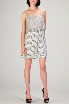 salediem.com sells boutique fashion each day.  Shipping is FREE!!This sleeveless flowy polka-dot and dots pleated cocktail dress has a layered design.