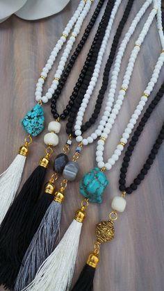 Long black beaded tassel necklace with jade gemstone. Long beaded tassel…