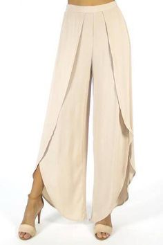 """Airy and effortless, these split-seam pants from Olivaceous boast a so-now wide leg and slouchy-chic fit. Wear this high-waist pair with delicately strapped sandals for an instant style lift. Fits true to size, order your normal size Cut for a relaxed fit High rise, split front seams, tulip hem Elasticized back waistband,  pull-on style 13"""" rise, 28"""" inseam, 18"""" leg opening, based on a size small"""