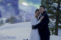 Winter & snow wedding with smoke bombs photo shoot. Long sleeveed wedding dress and bridal shawl. Blue and purple mountain wedding