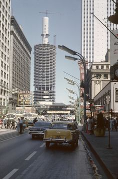 Traffic on State Street with a view of the construction on Marina Towers, 1962. http://chicagopast.com/post/29063268129