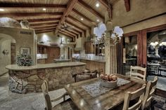 Eclectic Kitchen with Kitchen island, Simple granite counters, High ceiling, Ceiling fan, Concrete floors, Cokie Dining Chair