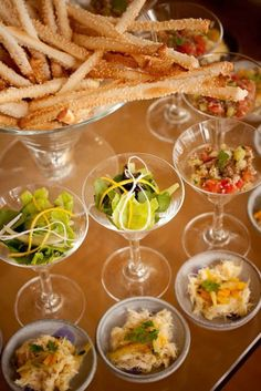 Finger foods. Plastic champagne or martini glasses for food...wonderful!