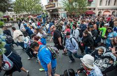Thousands of guests make their way along Main Street USA for the park to open for Disneyland's 60th birthday celebration Friday morning. http://www.ocregister.com/articles/disney-672399-disneyland-park.html