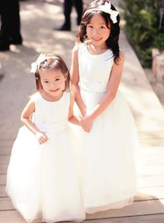 Bow headbands for the flower girls: http://www.stylemepretty.com/collection/2322/