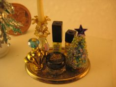 """Studio E: Chanel style perfumes bath accessories. Not really a tutorial, but photo shows some clever examples of perfume bottles made from beads. From Elizabeth's blog """"Studio E""""."""