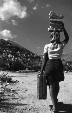 Italian Vintage Photographs ~ #Italian #Vintage #Photographs  Woman Carrying Suitcase in Cassino 1945