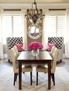 So much to love here: the contrast of hot pink against neutrals and B, gorgeous mirror, stunning chandelier...wow!