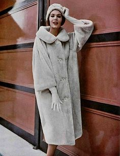 Simone in a beige sheared beaver coat by Dior, 1958  Photo by Philippe Pottier