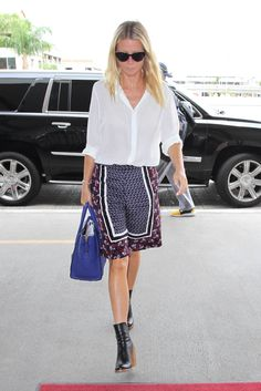 Gwyneth Paltrow pairs a simple white button-up with cool, printed bottoms