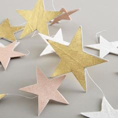 Star garland.  Good DIY for photo book backdrop