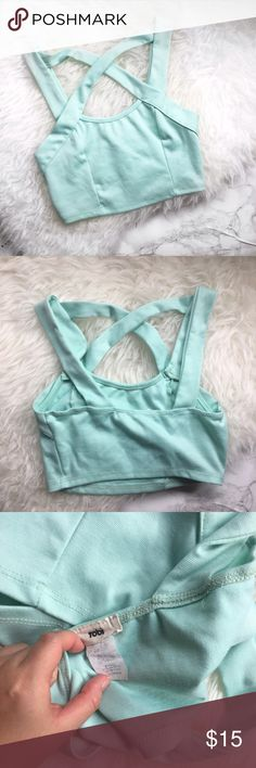 Tobi mint crop top with crisscross details Super cute mint green crop top with crisscross details on the front. Stretchy material. Only worn twice. No trades. Tobi Tops Crop Tops