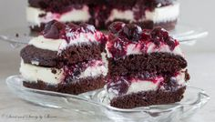 Rich chocolate cake filled with delicate white chocolate mousse and cherry sauce is ultimate chocolate heaven!
