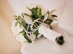 Bridal Bouquet ~ Stems bound with lace & pearl top pins. strings of pearls added to the bouquet / By Spriggs Florist, via Flickr