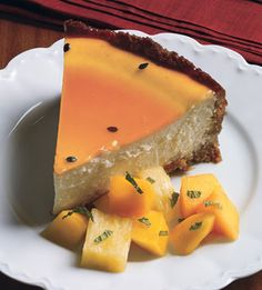 Coconut Cheesecake with Passion Fruit Glaze - use macadamia nuts instead of graham crackers and coconut oil instead of butter? or butter. use krisda instead of sugar; for compote, dragonfruit is pretty damn delicious. so is star fruit. and guava! and coconut! try to find these to add to topping?  need springform pan.