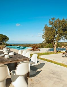Portgual mod summer home, Nuno Benito, outdoor pool, view, Panton chairs, rustic table