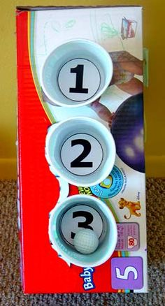 Toddler Skeeball! Easy to make and a great activity! I know my son loves to throw things and this is a creative way to help release all that energy!   http://www.toddlertoddler.com/todaysskeetball.htm
