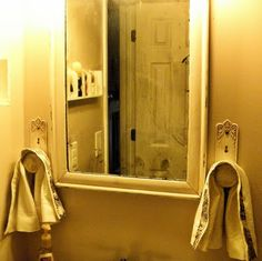 Great idea for hanging hand towels in guest bathroom.