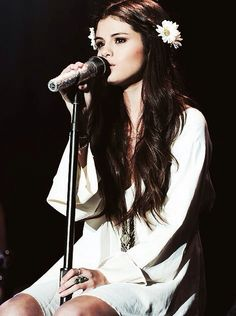 Selena Gomez omg i love you sister you are so cute and we have the same clothes and hair and eyes and same everything