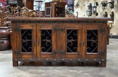 The Alamo TV Stand is a solid mesquite TV stand featuring wrought iron accents and hardware.