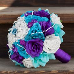 Add green and do jewels instead of pearls. Royal purple and turquoise large bridal bouquet by TheBridalFlower, $140.00