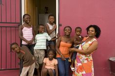 An SOS family outside their home in SOS Children's Village Nelspruit, South Africa