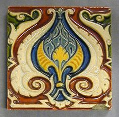 "Craven Dunnill and Co plastic clay majolica glazed tile with a stylized acanthus border design, polychrome glazes, 6"" square, c1880."