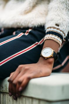 Black and gold make the most glamourous pairing and Mondaine's leather trimmed watch is a shining example. Wear to let a glimmer of shine poke out of a chunky Aran knit this winter.