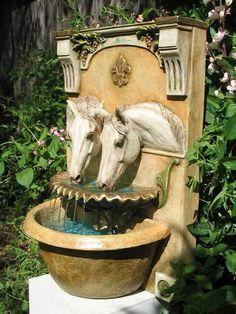 2 horses at a fountain