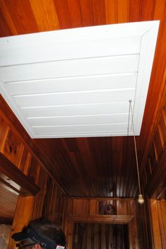 House by Holly: To Paint Knotty Pine or Not Paint Knotty Pine? That is the Question. Knotty Pine Paneling, Knotty Pine Walls, White Paneling, Painted Wood Walls, Wood Panel Walls, White Wash Fireplace, White Washed Furniture, Painting Wood Paneling, Slanted Ceiling