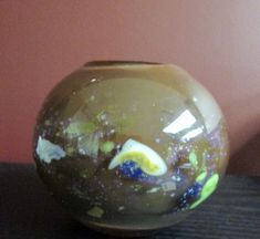 Appears to be blown glass with ground and polished bottom. The colors are lovely, brown with chunks of milky glass cased in clear glass with iridescent motley speckles and craters on the surface, very masculine in appearance, not signed. Elephant Figurines, Rose Bowl, Egg Shape, Glass Paperweights, Studio Art, Ship Art, Modern Retro, Bud Vases, Paper Weights