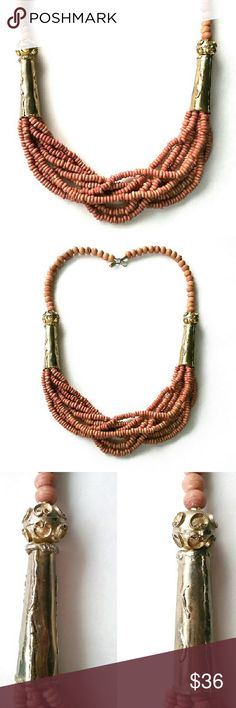 Vintage Brutalist Style Brass & Wood Bead Necklace Cool boho, ethnic style multistrand necklace. Made of wooden beads, accented by beautiful brutalist-style brass cones and accent beads on each side. At once both art-to-wear and tribal in feeling. Wear all one color and sport this statement piece around your neck! In very good vintage condition with a few chipped beads near back closure (please see photos). Circa: 1970s/1980s. Brass brutalist-style accent beads & cones, wooden beads…