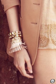 layering the bracelets. Love the fringe at the end