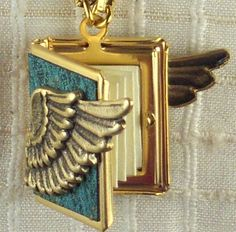 WINGED peace Book Necklace--holding 14 words for 'peace' from around the world