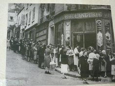 Long queues outside food store. German-occupied Lyon, WW2