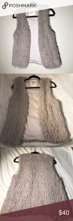 Dylan Los Angeles Size S Faux Fur Vest This is a soft and fluffy dusty rose/light purple faux fur vest from Dylan Los Angeles in a Size S.  I bought it in an attempt to pull off a sort of trophy wife in Aspen-esque look and I loved it!  On me it falls about three inches below the belt line.  It's so soft and pretty, and made in LA! Dylan Jackets & Coats Vests
