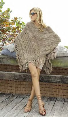 inspiration pic - poncho, knit one long strip, join as in picture. Poncho 7b5d8fb721f