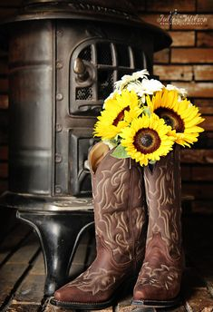 Adorable wedding cowgirl boots and sunflower bouquet :)
