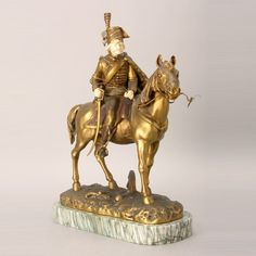 George Omerth Gilt Bronze and Marble Figure of a Soldier on Horseback, signed G. Omerth {Height with base 15 inches; length 11 inches}