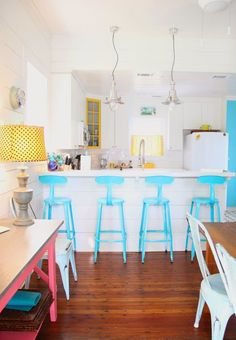 For those lucky enough to have an island or a U-shaped counter or breakfast bar, let us strongly recommend investing in some colorful bar stools. No matter the style or color scheme of your kitchen, adding a bright (or at least colorful) stool is a low-commitment way to liven up your space. Whether you buy brand-new stools or give your existing ones a DIY makeover with some spray paint, we bet you'll love the new look.