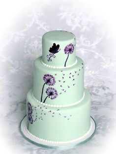 Mint green wedding cake with purple hand-painted dandelions