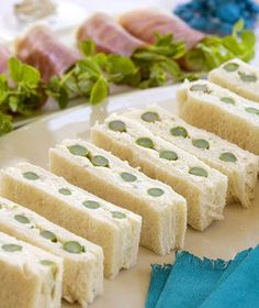 Asparagus and Cream cheese sandwiches. I like the greens wrapped in meat on the side. pretty.