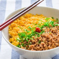 Soboro Don (そぼろ丼) is a simple Japanese rice bowl with sweet and savory ground chicken and some seasoned scrambled egg. It comes together in minutes making it a perfect weeknight meal, or an easy bento lunch to go.