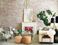 contemporary grace An exposed brick wall sets the scene in Lauren Conrad's Beverly Hills home. The elegantly curated space features a perfect balance of vintage decor and modern finds.