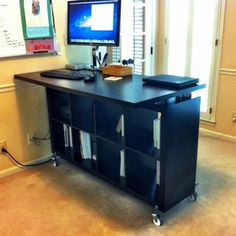 Standing IDEA desk: Expedit Book Case, Vika Desktop, CDs, casters