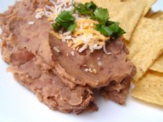 Easy crock pot refried beans.  Just made these today. Yummy!  I just soaked them over night, rinsed, put in fresh water and cooked on high for 6 hours in the crock pot. Then fry in oil and mash.  (click on her link to slow cooker pinto beans)
